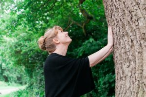 Lindsey Hood touching tree